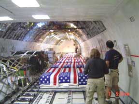 Coffins returning from Iraq with fallen US troops. Too sad for words. This kind of photo could end the war, though. It's called the Dover Effect.